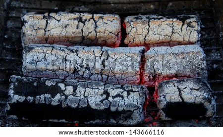 glowing embers from wooden briquettes. background. texture. - stock photo