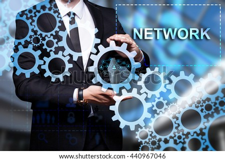 "Glowing gear with icon ""Network"" in the hands of a businessman. Business concept. Internet concept. - stock photo"