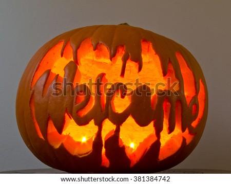 Glowing Halloween Jack-o-lantern pumpkin with the word - stock photo