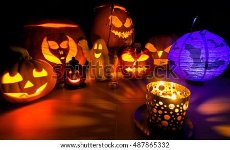 Glowing Halloween pumpkin, warm candle light, autumn holiday background, traditional jack-o-lantern scenery