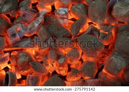 Glowing Hot Charcoal Briquettes Close-up Background Texture - stock photo