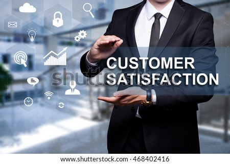 "Glowing icon ""Customer Satisfaction"" in the hands of a businessman. Business concept. Internet concept."