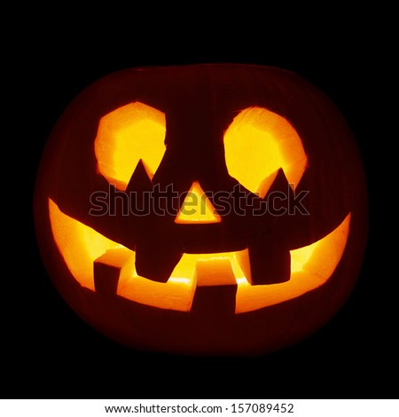 Glowing Jack-o'-lantern pumpkin isolated over black background - stock photo
