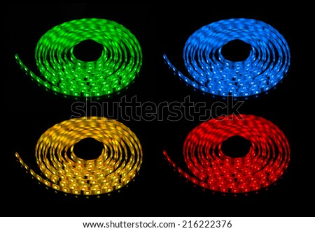 glowing LED garland, red, green, blue and yellow strip - stock photo