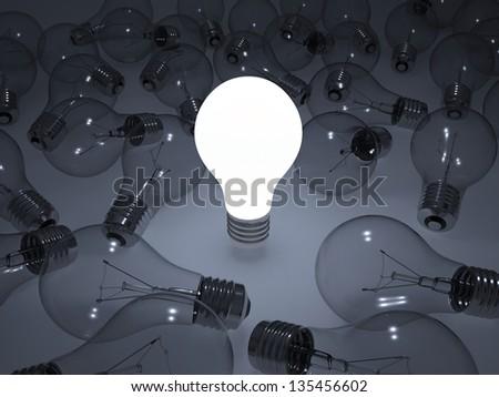 Glowing light bulb. Around that do not light bulbs. 3d render - stock photo