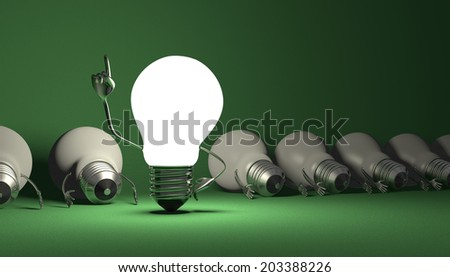 Glowing light bulb character in moment of insight standing among many switched off lying ones on green textured background - stock photo