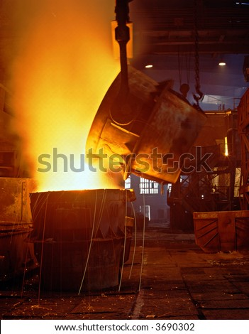 Glowing, molten hot steel. Stell casting. - stock photo