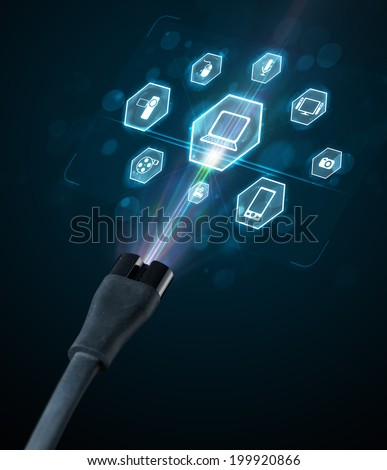 Glowing multimedia icons coming out of electric cable - stock photo