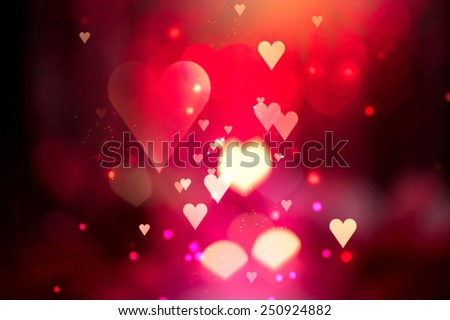 Glowing Red hearts love background. St. Valentine's Day holiday abstract glowing blurred bokeh. Defocused blinking heart shaped lights. Valentine Hearts Abstract Wallpaper. Backdrop - stock photo