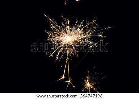 Glowing Sparks in the dark - stock photo