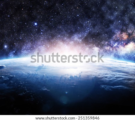 Glowing Sunrise Over Earth - Elements of this Image Furnished by NASA - stock photo