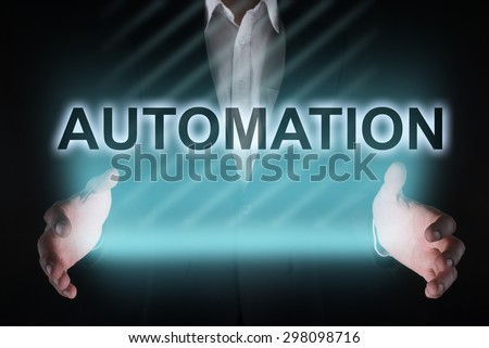 "Glowing text ""Automation"" in the hands of a businessman. Business concept. Internet concept. - stock photo"