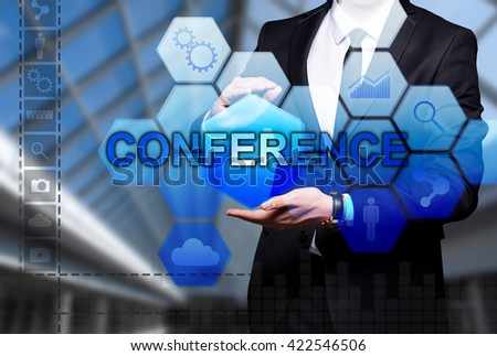 """Glowing text """"Conference"""" in the hands of a businessman. Business concept. Internet concept. - stock photo"""