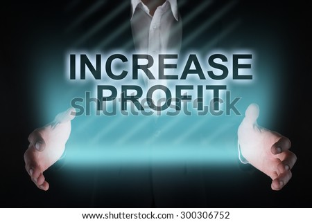 "Glowing text ""increase profit"" in the hands of a businessman. Business concept.  - stock photo"