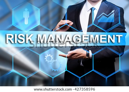 """Glowing text """"Risk Management"""" in the hands of a businessman. Business concept. Internet concept. - stock photo"""