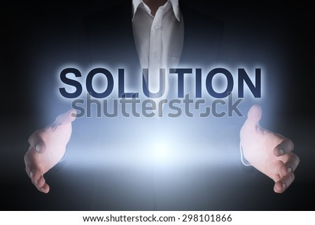 "Glowing text ""Solution"" in the hands of a businessman. Business concept. Internet concept. - stock photo"