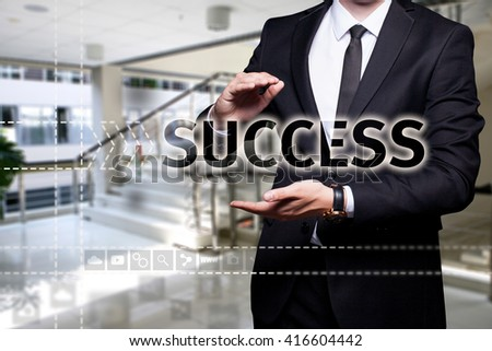 "Glowing text ""Success"" in the hands of a businessman. Business concept. Internet concept."