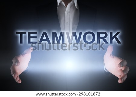 "Glowing text ""Teamwork"" in the hands of a businessman. Business concept. Internet concept. - stock photo"