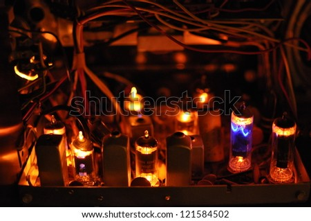 glowing tubes in antique radio - stock photo
