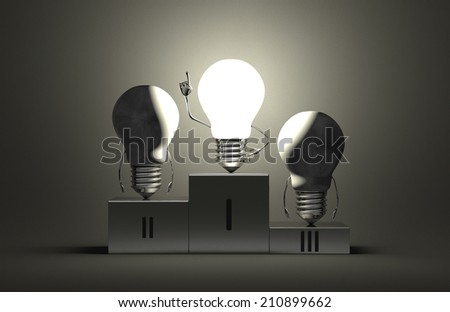 Glowing tungsten light bulb character in moment of insight and two switched off ones on podium on gray textured background - stock photo