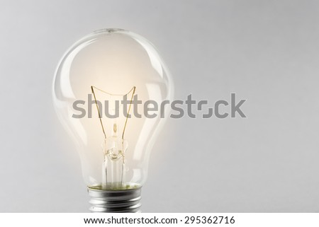 Glowing yellow light bulb, busienss idea concept - stock photo