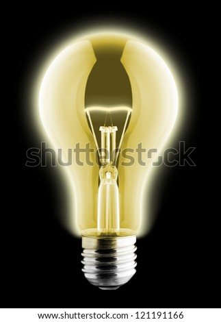 Glowing yellow light bulb on black - stock photo