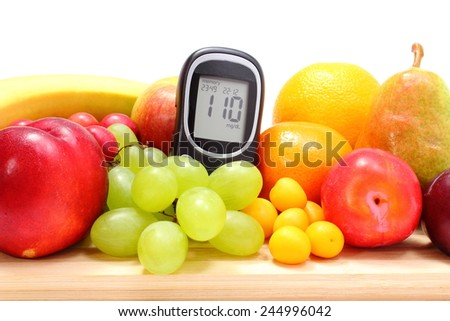 Glucose meter and fresh ripe fruits lying on wooden cutting board, concept for healthy eating and diabetes. Isolated on white background