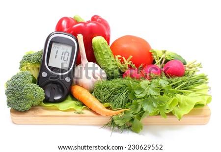 Glucose meter and fresh ripe raw vegetables lying on wooden cutting board, desk of healthy organic vegetables, concept for healthy eating and diabetes. Isolated on white background - stock photo