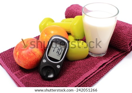 Glucose meter, fresh fruits, glass of milk and dumbbells on purple towel, concept for diabetes lifestyle and healthy nutrition - stock photo
