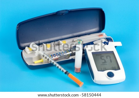 Glucose meter, Insulin pen injection - stock photo