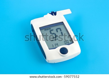 Glucose meter on a blue background