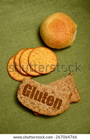 gluten concept with bread, crackers and a roll - stock photo