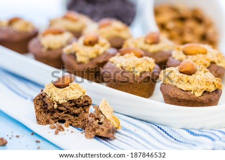 Gluten free chocolate baked snacks with peanut butter and whole almond.