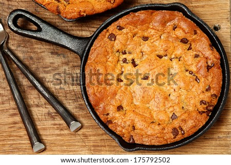 Gluten Free Chocolate Chip Skillet Cookie on table. - stock photo