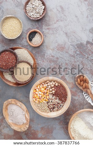 Gluten free grains and flours. Assorted  gluten free  grains in various containers , top view, blank space
