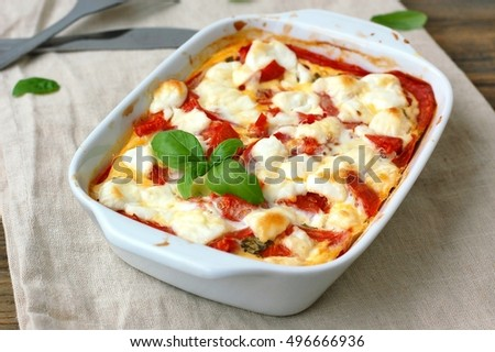 Gluten free meal from roasted corn flour polenta, tomato, goat cheese ...