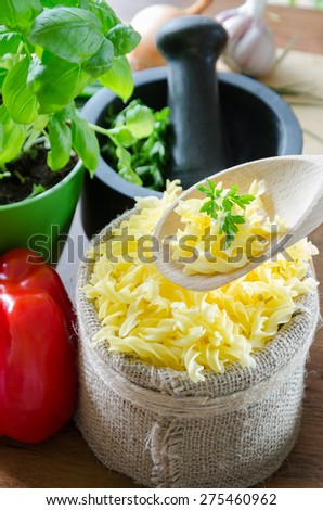 gluten-free pasta with tasty toppings: garlic, paprika, basil, vegetables - stock photo