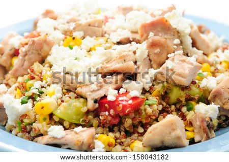 gluten free  salad made with quinoa, chicken, feta and fresh heirloom tomatoes - stock photo