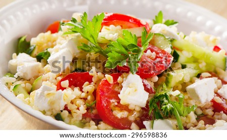 Gluten free vegetarian salad  with  feta cheese. Selective focus - stock photo