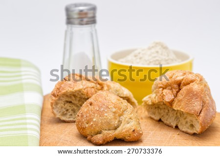 Gluten's buns and oat bran - on the background: salt and flour - stock photo