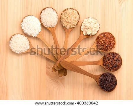 Glutionus Mixed whole grain traditional thai rices best rices for healthy  in wood spoon on weathered wood background - stock photo