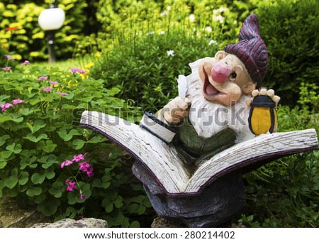 Gnome in a garden - stock photo