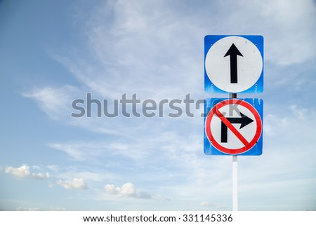 go ahead the way ,forward sign and don't turn right sign with blue sky blank for text - stock photo