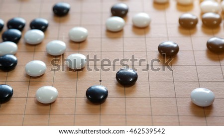 Go board,traditional Chinese strategy board game.Game brain training.and have an orange light like the sun.