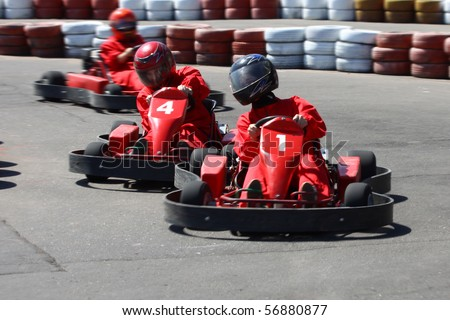 Go cart racers struggling on circuit.