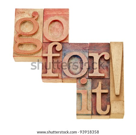 go for it - motivation concept - isolated words in vintage wood letterpress printing blocks - stock photo