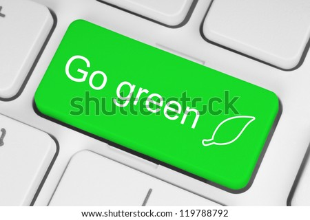 Go green button on keyboard background - stock photo