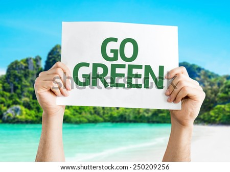 Go Green card with beach background - stock photo