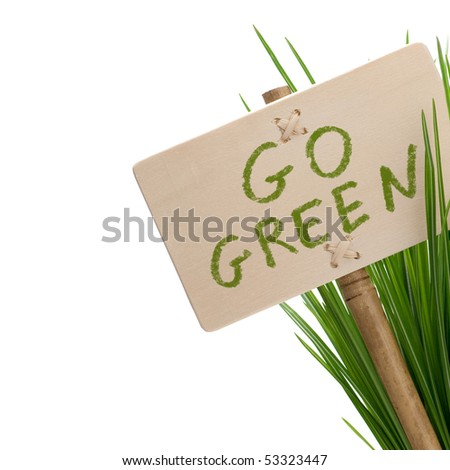 go green message on a wooden panel and green plant - image is isolated on a white background - stock photo