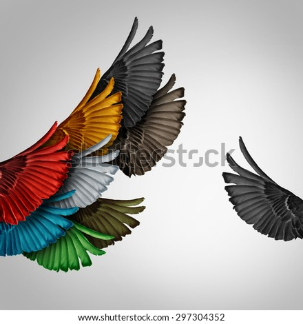 Go it alone concept and Independent thinker idea or new leadership concept and individuality as a group of flying bird wings with one wing independent as a business icon for an entrepreneur spirit. - stock photo